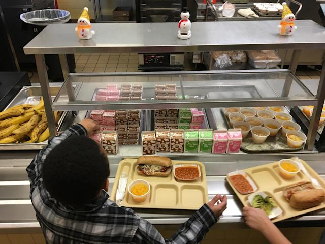 Students fill their lunch trays at J.F.K Elementary School in Kingston, N.Y., where all meals are now free.