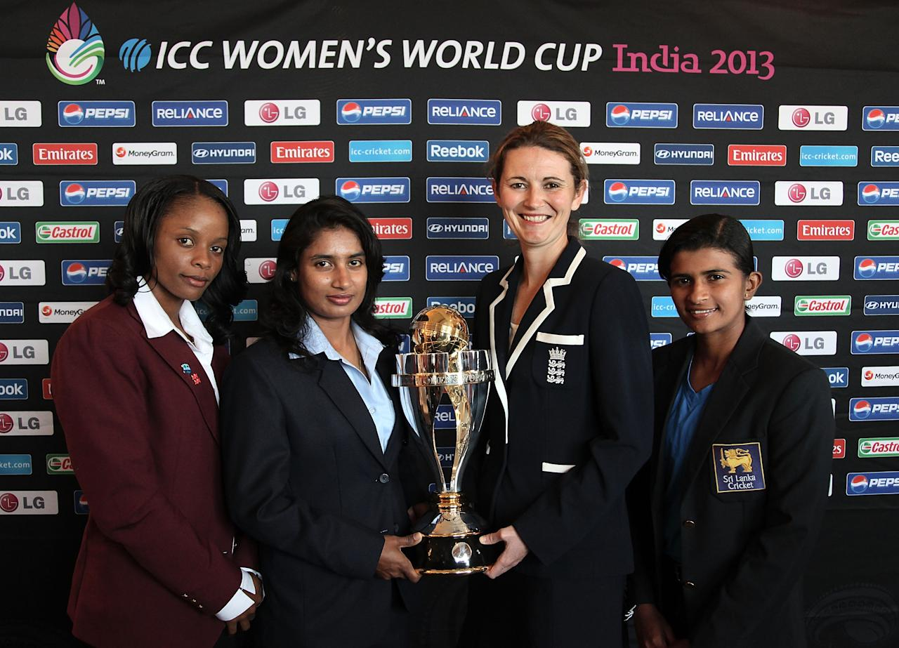 [ICCWWC2013] MUMBAI, INDIA - JANUARY 27: (L-R) Merissa Aguilleira of West Indies, Mithali Raj of India, Charlotte Edwards of England and Shashikala Siriwardena of Sri Lanka with the ICC Womens World Cup trophy attend the Captains Group A Press Conference at the Taj Mahal Palace Hotel on January 27, 2013 in Mumbai, India. (Photo by Graham Crouch ICC via Getty Images)
