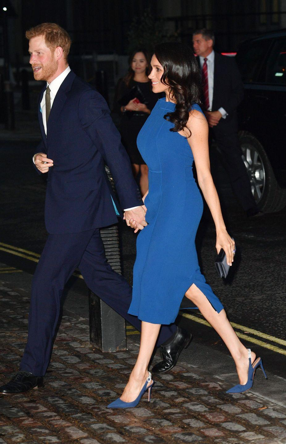 """<p>Meghan Markle <a href=""""https://www.townandcountrymag.com/style/fashion-trends/a22989033/meghan-markle-jason-wu-dress-100-days-to-peace-gala-2018/"""" rel=""""nofollow noopener"""" target=""""_blank"""" data-ylk=""""slk:stepped out"""" class=""""link rapid-noclick-resp"""">stepped out</a> in a navy blue dress by Jason Wu complete with a pair of Aquazzura pumps, a black clutch, and a wavy blow out while attending the <a href=""""https://www.townandcountrymag.com/society/tradition/g22989148/prince-harry-meghan-markle-100-days-to-peace-gala-photos/"""" rel=""""nofollow noopener"""" target=""""_blank"""" data-ylk=""""slk:100 Days of Peace Gala"""" class=""""link rapid-noclick-resp"""">100 Days of Peace Gala</a>.</p>"""