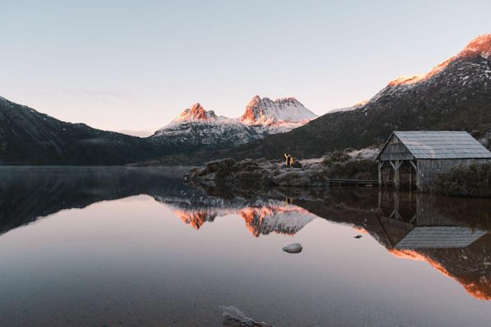 "<p>Frosted mountain peaks reflect on the waters of Cradle Mountain Lake in St. Clair National Park.</p><p><strong>Related: <a href=""https://www.redbookmag.com/life/g32293087/australian-outback-photos/"" rel=""nofollow noopener"" target=""_blank"" data-ylk=""slk:These Photos of the Australian Outback Bring Social Distancing to a Whole Other Level"" class=""link rapid-noclick-resp"">These Photos of the Australian Outback Bring Social Distancing to a Whole Other Level</a></strong></p>"