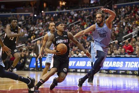 Mar 16, 2019; Washington, DC, USA; Washington Wizards guard Bradley Beal (3) drives to the basket as Memphis Grizzlies center Joakim Noah (55) defends during the fourth quarter at Capital One Arena. Mandatory Credit: Tommy Gilligan-USA TODAY Sports