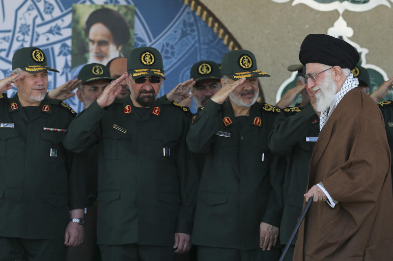 FILE - In this May 20, 2015 file photo, released by an official website of the office of the Iranian supreme leader, Gen. Hossein Salami, second right, salutes as Supreme Leader Ayatollah Ali Khamenei, right, arrives at a graduation ceremony of the Revolutionary Guard's officers in Tehran, Iran. Iran's supreme leader has appointed Salami to head to the country's powerful Revolutionary Guard, just after the U.S. designated the paramilitary force a terrorist group. Former commanders of the Revolutionary Guard Mohsen Rezaei, second left, and Yahya Rahim Safavi salute. (Office of the Iranian Supreme Leader via AP, File)