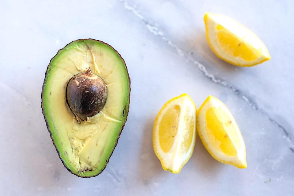 """<p>If you happen to have half an avocado left after using some to top your <a href=""""https://www.thedailymeal.com/our-50-best-burger-recipes-gallery?referrer=yahoo&category=beauty_food&include_utm=1&utm_medium=referral&utm_source=yahoo&utm_campaign=feed"""" rel=""""nofollow noopener"""" target=""""_blank"""" data-ylk=""""slk:burger"""" class=""""link rapid-noclick-resp"""">burger</a> or put into your <a href=""""https://www.thedailymeal.com/best-scrambled-eggs?referrer=yahoo&category=beauty_food&include_utm=1&utm_medium=referral&utm_source=yahoo&utm_campaign=feed"""" rel=""""nofollow noopener"""" target=""""_blank"""" data-ylk=""""slk:perfectly scrambled eggs"""" class=""""link rapid-noclick-resp"""">perfectly scrambled eggs</a>, you can save the other half from oxidizing by squeezing a bit of lemon or lime juice on the exposed portion of the avocado. Citric acid acts as a natural preservative. Wrap the avocado tightly with plastic wrap and store it upside down in your fridge, or pop it into an <a href=""""https://www.thedailymeal.com/cook/10-things-make-your-kitchen-greener-slideshow?referrer=yahoo&category=beauty_food&include_utm=1&utm_medium=referral&utm_source=yahoo&utm_campaign=feed"""" rel=""""nofollow noopener"""" target=""""_blank"""" data-ylk=""""slk:avocado hugger, which is one of many sustainable kitchen products"""" class=""""link rapid-noclick-resp"""">avocado hugger, which is one of many sustainable kitchen products</a> we love. However, if you want to speed up the ripening process, follow<a href=""""https://www.thedailymeal.com/cook/how-to-ripen-avocados-fast?referrer=yahoo&category=beauty_food&include_utm=1&utm_medium=referral&utm_source=yahoo&utm_campaign=feed"""" rel=""""nofollow noopener"""" target=""""_blank"""" data-ylk=""""slk:these helpful tips"""" class=""""link rapid-noclick-resp""""> these helpful tips</a>.</p>"""