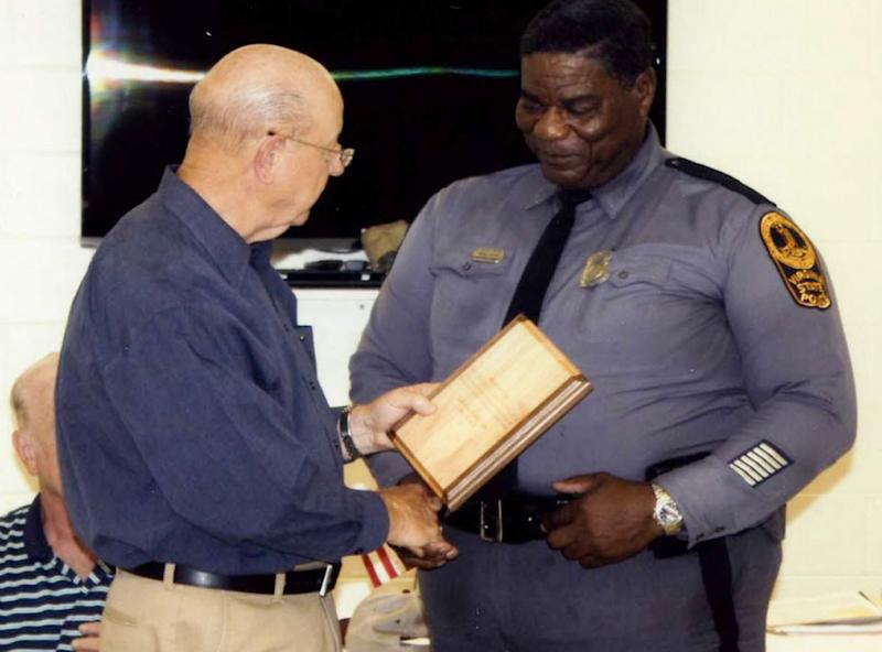 In this May 2012 photo, Virginia State Police Master Trooper J.A. Walker is honored by the Sutherland Rotary Club of Sutherland, Va. Walker was killed in the line of duty Thursday, March 7, 2013 in a shooting on Interstate 85 in Dinwiddie County, Va. (AP Photo/The Progress-Index)