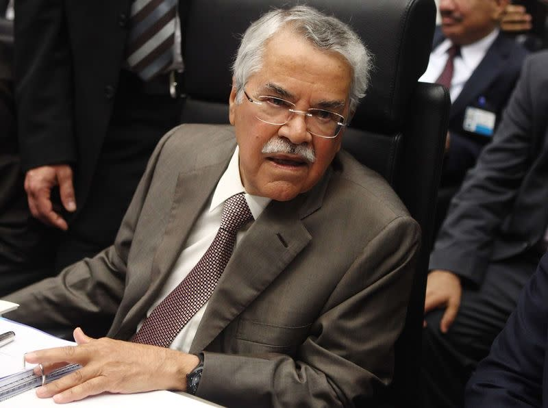 File photo of Saudi Arabia's Oil Minister al-Naimi talking to journalists before a meeting of OPEC oil ministers in Vienna