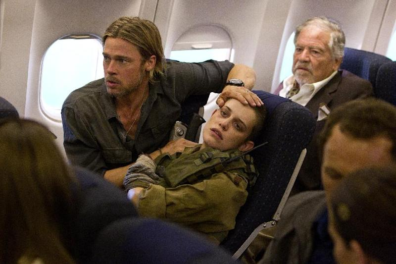 """This publicity image released by Paramount Pictures shows Brad Pitt as Gerry Lane, left, and Daniella Kertesz as Segen, center in a scene from """"World War Z."""" (AP Photo/Paramount Pictures, Jaap Buitendijk)"""