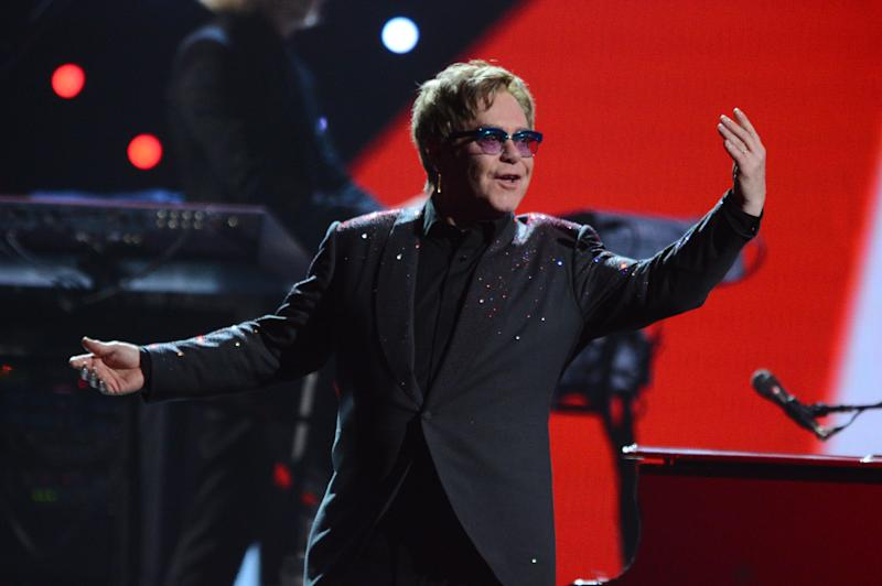 This Sept. 20, 2013 photo shows Elton John performing at the iHeartRadio Music Festival in Las Vegas, Nev. (Photo by Al Powers/Powers Imagery/Invision/AP)