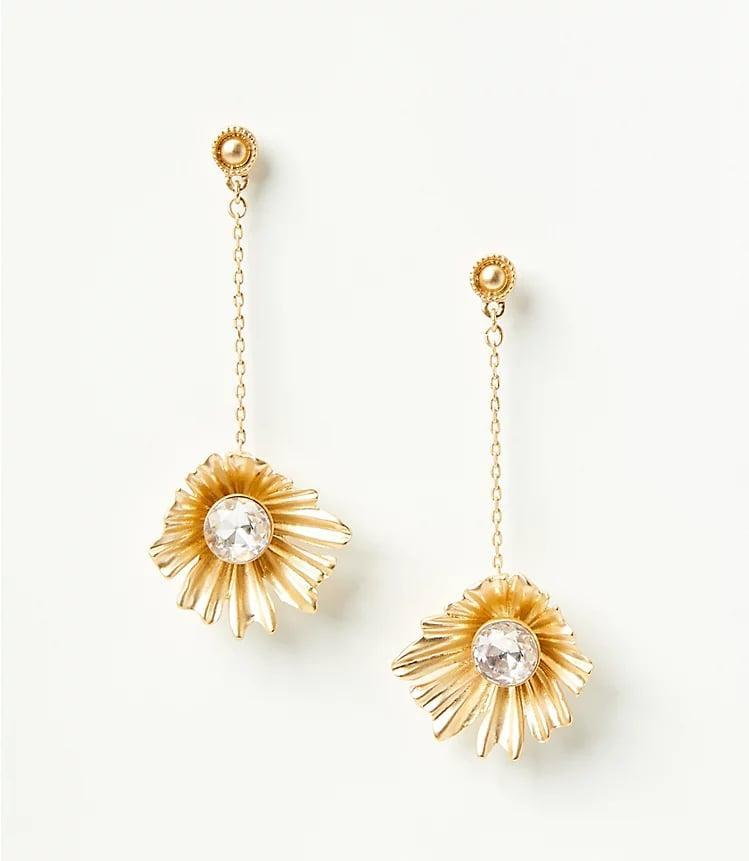 <p>A beautiful accessory addition are these <span>Sparkle Floral Statement Earrings</span> ($35).</p>
