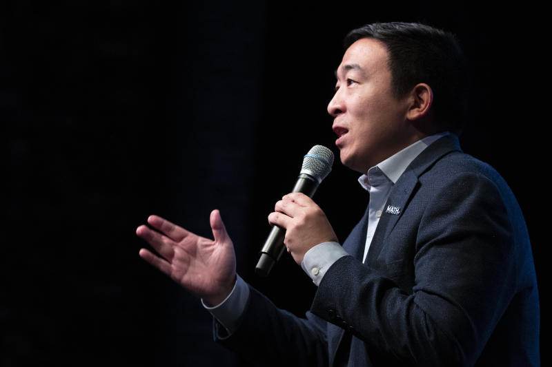 """FILE - In this Feb. 5, 2020, file photo, Democratic presidential candidate and entrepreneur Andrew Yang speaks during the New Hampshire Youth Climate and Clean Energy Town Hall, in Concord, N.H. Yang recently drew backlash from fellow Asian Americans for urging them to display more """"American-ness."""" (AP Photo/Mary Altaffer, File)"""