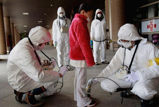 PHOTO: In this March 24, 2011 file photo, a young evacuee is screened at a shelter for leaked radiation from the tsunami-ravaged Fukushima Dai-ichi nuclear power plant in Fukushima, northeast of Tokyo. (Wally Santana/AP, FILE)