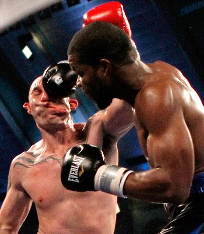Boxer Lavarn Harvell (R) connects to the head of Tony Pietrantonio for a knockout during their third round of light heavyweight boxing fight in Atlantic City, New Jersey April 28, 2012. REUTERS/Tim Shaffer