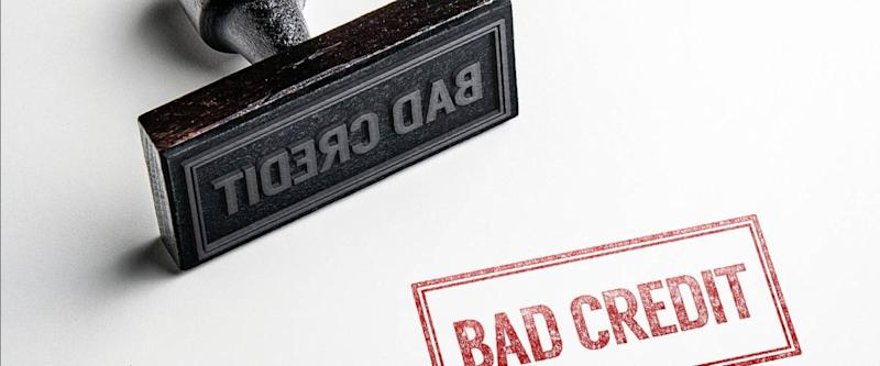 Rubber stamping that says 'Bad Credit'.