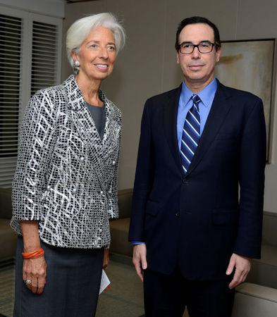 """U.S. Treasury Secretary Steven Mnuchin (R) and IMF Managing Director Christine Lagarde pose for photographers prior to holding """"A Conversation on the US Economy"""", as part of the IMF and World Bank's 2017 Annual Spring Meetings, in Washington, U.S., April 22, 2017.   REUTERS/Mike Theiler"""