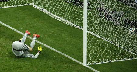 Brazil's goalkeeper Julio Cesar fails to save a shot from Georginio Wijnaldum (not pictured) of the Netherlands during their 2014 World Cup third-place playoff at the Brasilia national stadium in Brasilia July 12, 2014. REUTERS/Ruben Sprich