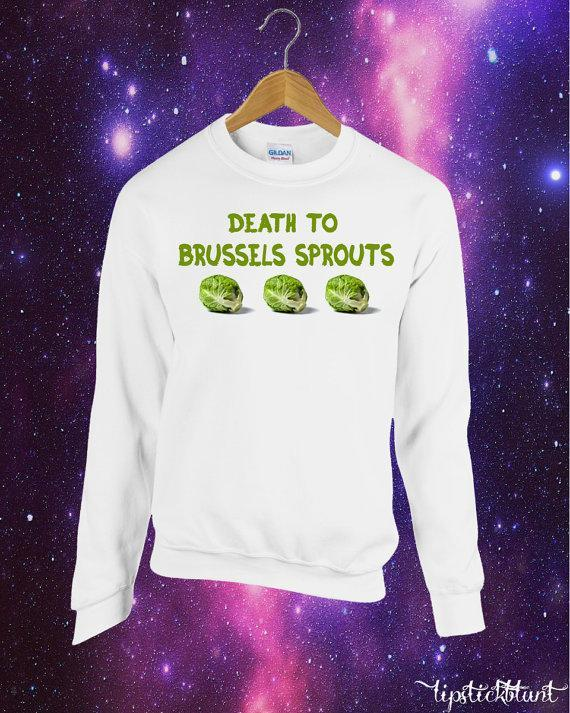 """<p>£13.99, <a href=""""https://www.etsy.com/uk/listing/463120447/death-to-brussels-sprouts-printed?ga_order=most_relevant&ga_search_type=all&ga_view_type=gallery&ga_search_query=Christmas%20jumper&ref=sr_gallery_13"""" rel=""""nofollow noopener"""" target=""""_blank"""" data-ylk=""""slk:Etsy"""" class=""""link rapid-noclick-resp"""">Etsy</a></p>"""