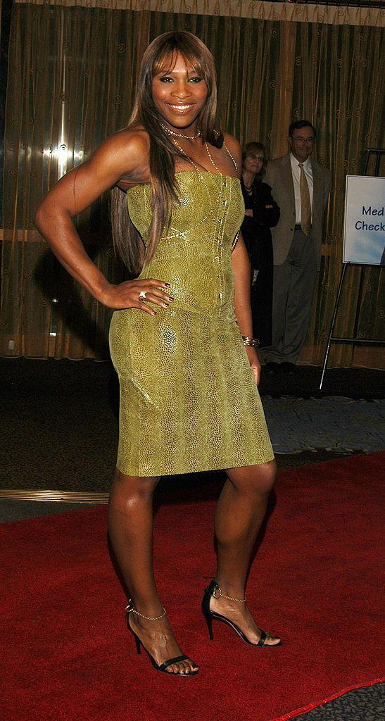 <p>Williams wore another corset and wiggle skirt, this time in a snake print. </p>