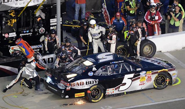 Sparks fly from NASCAR Nationwide driver Kevin Harvick's car during a late pit stop in the NASCAR Nationwide Cup Series Great Clips 300 auto race at Atlanta Motor Speedway, Saturday, Aug. 30, 2014 in Hampton, Ga. (AP Photo/Joe Sebo)