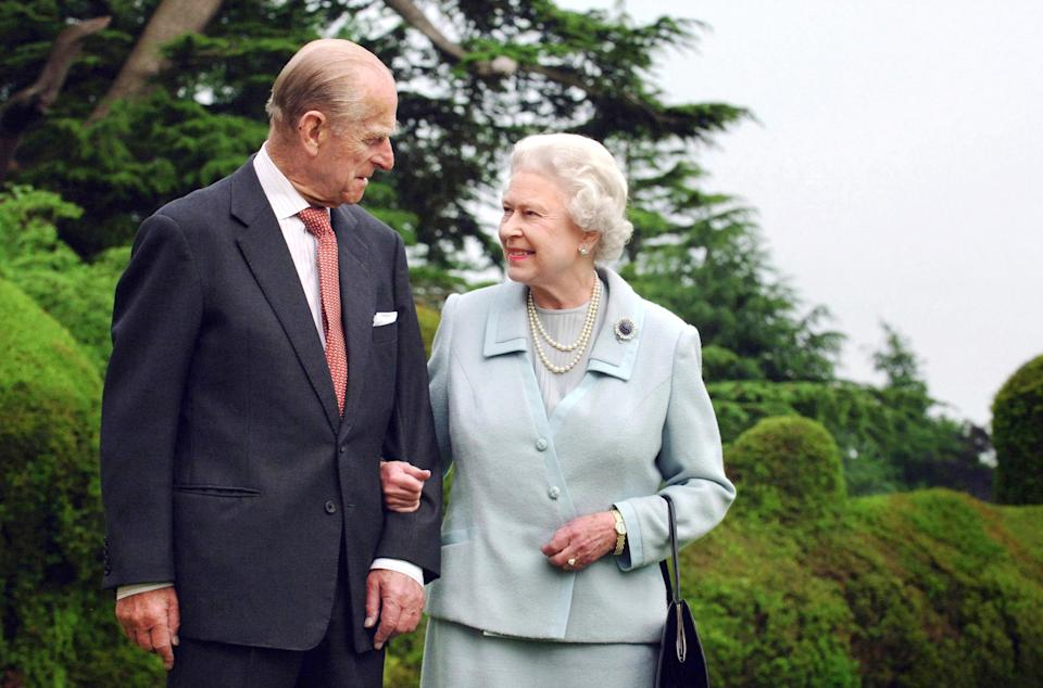 Picture released 18 November 2007 shows Britain's Queen Elizabeth II and her husband, the Duke of Edinburgh walk at Broadlands, Hampshire, earlier in the year. - Queen Elizabeth II and Prince Philip are to mark their diamond wedding anniversary in reserved style 19 November 2007 before jetting off to Malta to revive golden memories of their newlywed youth. Queen Elizabeth, 81, is known to cherish the time they spent on the Mediterranean island as a young couple, out of Britain and out of the spotlight in the years before she inherited the throne aged 25 in 1952. (Photo by Fiona HANSON / POOL / AFP) (Photo by FIONA HANSON/POOL/AFP via Getty Images)