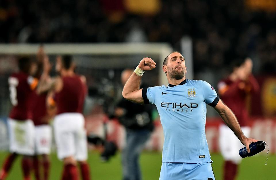 Manchester City's Pablo Zabaleta celebrates after scoring during the UEFA Champions League match against AS Roma on December 10, 2014 at the Olympic stadium in Rome (AFP Photo/Gabriel Bouys)