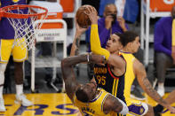 Golden State Warriors forward Juan Toscano-Anderson, right, shoots as Los Angeles Lakers forward LeBron James defends during the second half of an NBA basketball Western Conference Play-In game Wednesday, May 19, 2021, in Los Angeles. (AP Photo/Mark J. Terrill)