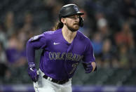 Colorado Rockies' Brendan Rogers heads up the first-base line after flying out against Arizona Diamondbacks relief pitcher Riley Smith in the fifth inning of a baseball game Friday, May 21, 2021, in Denver. (AP Photo/David Zalubowski)