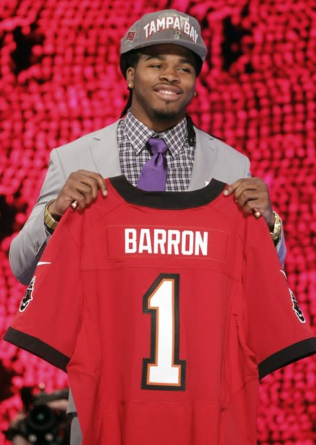 Alabama's Mark Barron poses for photographs after being selected as the seventh pick overall by the Tampa Bay Buccaneers in the first round of the NFL football draft at Radio City Music Hall, Thursday, April 26, 2012, in New York. (AP Photo/Jason DeCrow)