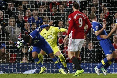 Everton's Ashley Williams handles the ball in the area resulting in a penalty for Manchester United and is later sent off