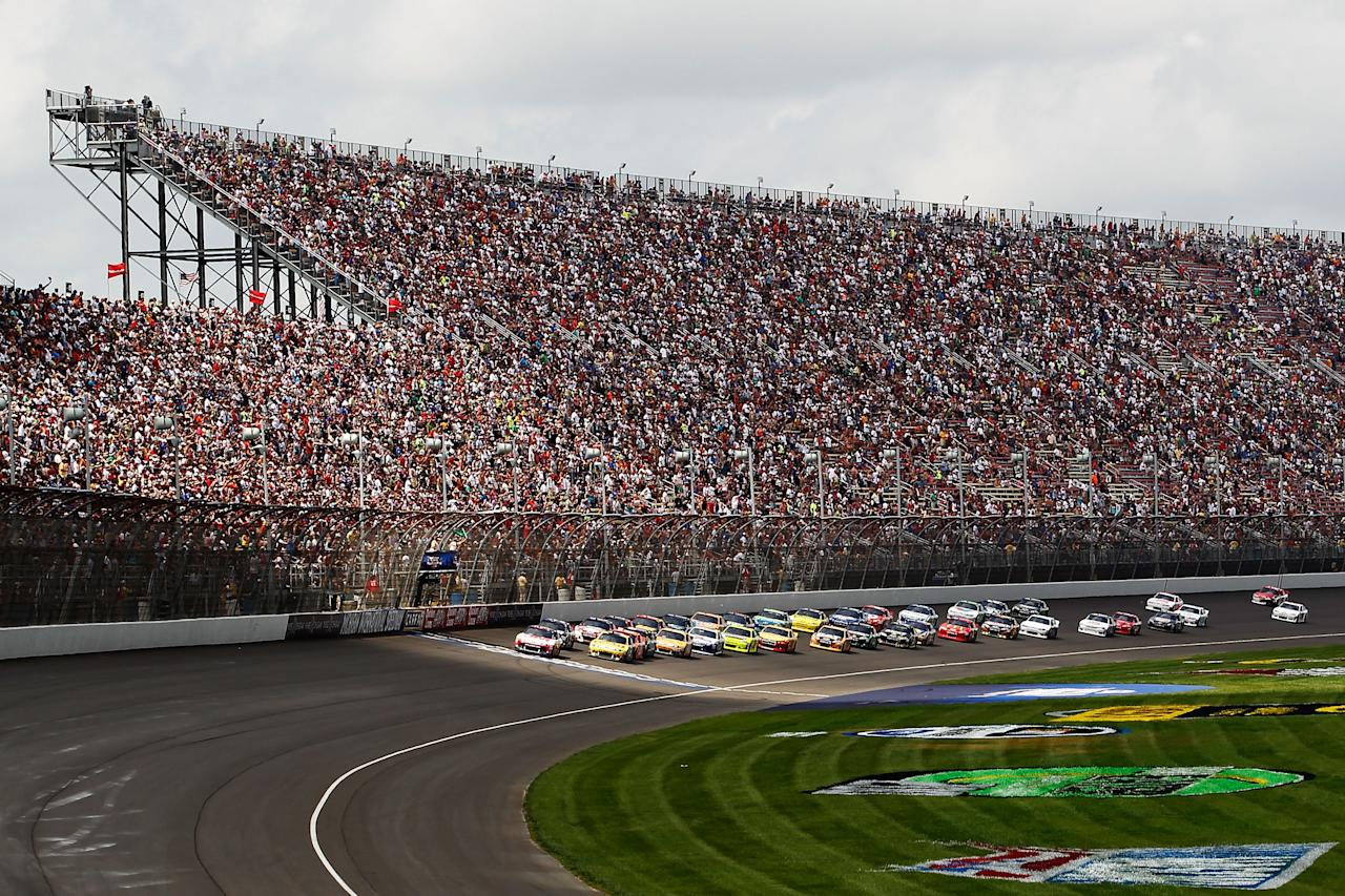 BROOKLYN, MI - JUNE 17:  Greg Biffle, driver of the #16 3M/Salute Ford, leads the field for a restart during the NASCAR Sprint Cup Series Quicken Loans 400 at Michigan International Speedway on June 17, 2012 in Brooklyn, Michigan.  (Photo by Jeff Zelevansky/Getty Images)