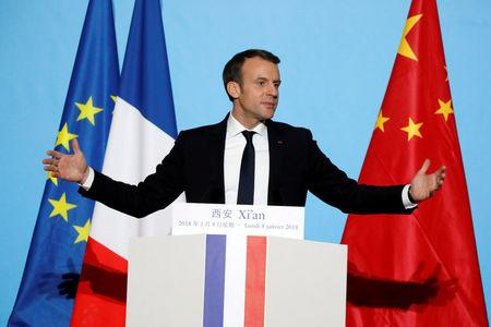 FILE PHOTO: French President Emmanuel Macron delivers his speech at the Daming Palace in Xian, Shaanxi province, China, January 8, 2018.  REUTERS/Charles Platiau/File Photo