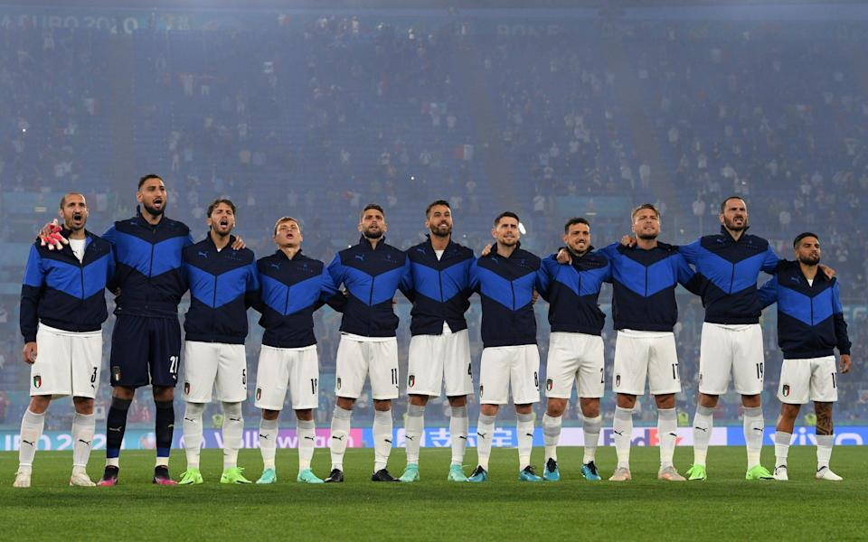 : Players of Italy line up to sing the national anthem prior to the UEFA - Getty Images