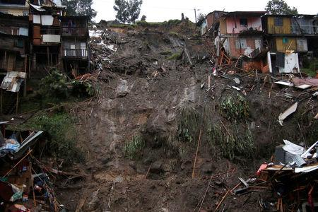 View of a neighborhood destroyed after mudslides, caused by heavy rains leading several rivers to overflow, pushing sediment and rocks into buildings and roads, in Manizales