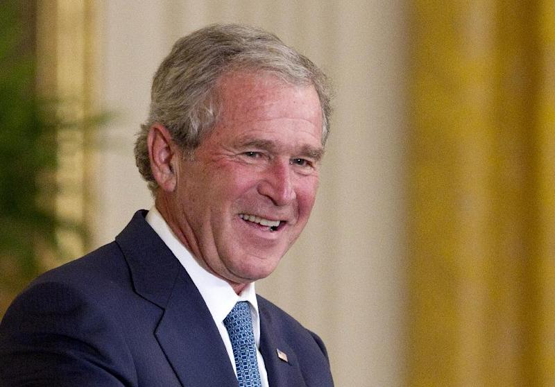 FILE - This May 31, 2013 file photo shows former President George W. Bush during the unveiling their of his in the East Room of the White House in Washington. Bush has successfully undergone a heart procedure after doctors discovered a blockage in an artery. (AP Photo/Carolyn Kaster, File)