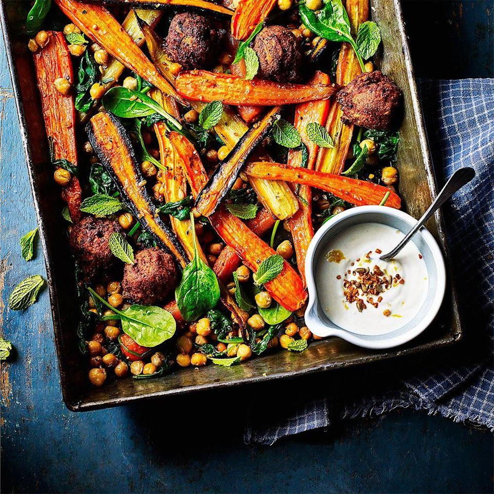"""<p>Roasting the chickpeas and carrots adds a crunchy sweetness to this traybake recipe.</p><p><strong>Recipe: <a href=""""https://www.goodhousekeeping.com/uk/food/recipes/a575070/carrot-chickpea-and-falafel-traybake/"""" rel=""""nofollow noopener"""" target=""""_blank"""" data-ylk=""""slk:Carrot, chickpea and falafel tray bake"""" class=""""link rapid-noclick-resp"""">Carrot, chickpea and falafel tray bake</a></strong></p>"""