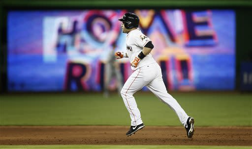 Miami Marlins batter Placido Polanco runs the bases after hitting a two-run-homer during the sixth inning of a baseball game against the Minnesota Twins in Miami, Wednesday, June 26, 2013. The Marlins won 5-3. (AP Photo/J Pat Carter)
