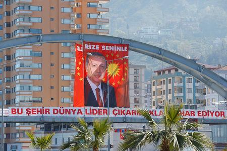 "A huge portrait of Turkish President Tayyip Erdogan is seen above a banner that reads ""This city is proud of raising a world leader"" in Rize"