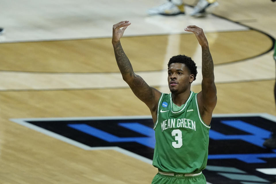 North Texas's Javion Hamlet reacts to fans during the first half of a first-round game against Purdue in the NCAA men's college basketball tournament at Lucas Oil Stadium, Friday, March 19, 2021, in Indianapolis. (AP Photo/Darron Cummings)