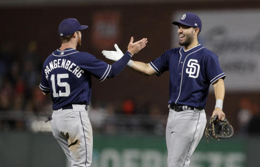 San Diego Padres' Eric Hosmer, right, celebrates with teammate Cory Spangenberg after the team's 6-2 win over the San Francisco Giants in a baseball game Friday, June 22, 2018, in San Francisco. (AP Photo/Marcio Jose Sanchez)