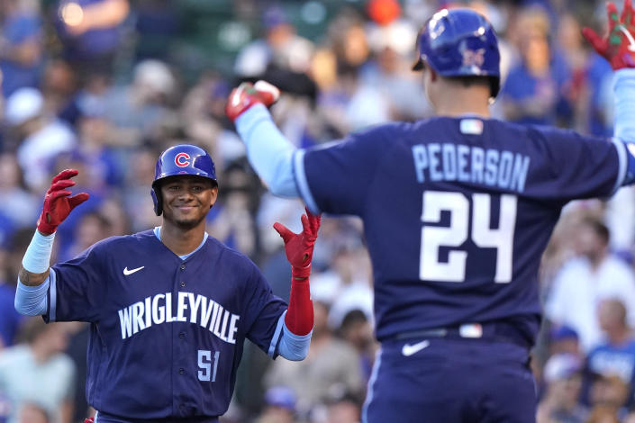 Chicago Cubs' Sergio Alcantara, left, celebrates with Joc Pederson after hitting a solo home run during the third inning of the team's baseball game against the St. Louis Cardinals in Chicago, Saturday, June 12, 2021. (AP Photo/Nam Y. Huh)
