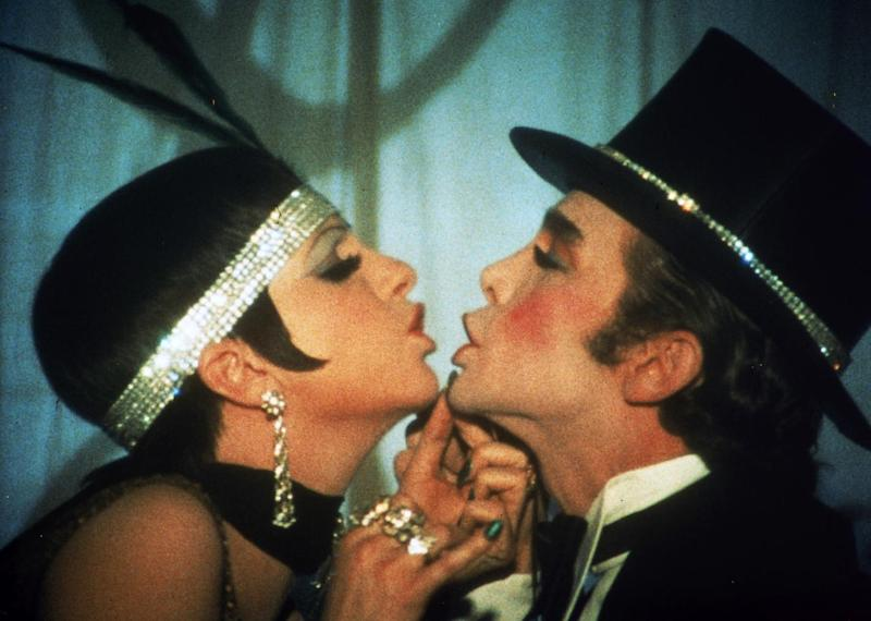 """This 1972 photo released by Warner Bros. Home Video shows Liza Minnelli as Sally Bowles, left, and Joel Grey as Master of Ceremonies in a scene from """"Cabaret.""""  The landmark film """"Cabaret"""", starring Liza Minnelli, Joel Grey and Michael York, has turned 41. All three actors will be attending an anniversary celebration screening planned Thursday, Jan. 31, 2013, at the Ziegfeld Theatre, where the movie first premiered in 1972. (AP Photo/Warner Bros. Home Video)"""