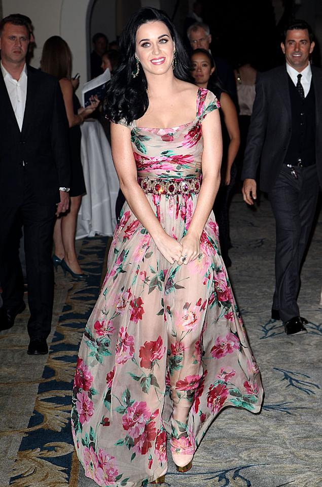 <br>Katy Perry has a style all her own – bright, bold, and over the top. So this floral Dolce & Gabbana dress, which the singer wore to the Dream Foundation Celebration of Dreams, was like a breath of fresh spring air! While flowery frocks can tend to be a tad boring (remember the Gunne Sax trend in the '80s?), the pop star's gown had a lot of flair – from the gemmed belt to the sheer skirt. Bringing together the whole look was Perry's minimal makeup. In this case, less was certainly more! (11/16/2012)<br>