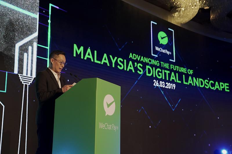 Poshu Yeung, Vice President of International Business Group at Tencent, presenting his speech on WeChat Pay MY's role in Malaysia's digital payment landscape.
