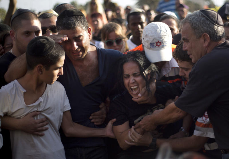 Smadar, mother of Israeli soldier, Staff Sergeant Gabriel Koby, mourns during his funeral at the military cemetery in Haifa, Israel, Monday, Sept. 23, 2013. Koby, 20, was shoot and killed by an unknown gunmen in the biblical city of Hebron in the West Bank on Sunday, and troops are searching for the shooter, the military said. It was the second soldier killed since the weekend when a Palestinian killed an Israeli soldier with the intention of trading the body for his brother who is jailed for shooting attacks. (AP Photo/Ariel Schalit)