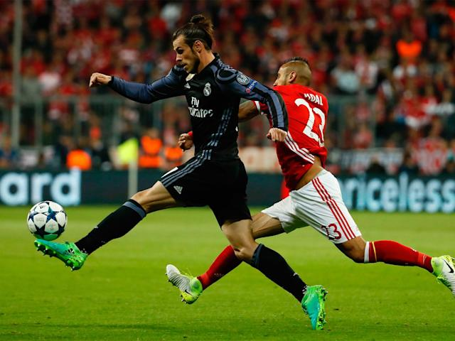 Gareth Bale carries the ball forward in the early stages at the Allianz Arena: Getty