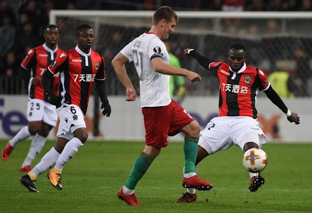 Soccer Football - Europa League Round of 32 First Leg - OGC Nice vs Lokomotiv Moscow - Allianz Riviera, Nice, France - February 15, 2018 Lokomotiv Moscow's Igor Denisov in action with Nice's Racine Coly REUTERS/Jean-Pierre Amet