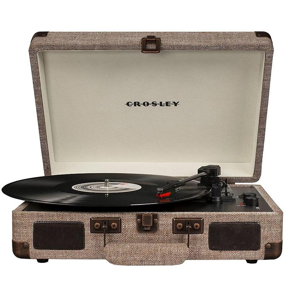 """<p><strong>Crosley</strong></p><p>amazon.com</p><p><strong>$64.95</strong></p><p><a href=""""https://www.amazon.com/dp/B07BBGLZCG?tag=syn-yahoo-20&ascsubtag=%5Bartid%7C2141.g.29492086%5Bsrc%7Cyahoo-us"""" rel=""""nofollow noopener"""" target=""""_blank"""" data-ylk=""""slk:Shop Now"""" class=""""link rapid-noclick-resp"""">Shop Now</a></p><p>He can finally listen to his favorite LPs the way they're meant to be played—on an old-school record player that <em>also</em> has Bluetooth capabilities for all the newer stuff. Younger and older fathers alike will love the throwback design.<br></p>"""