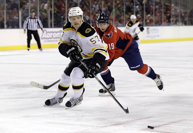 Boston Bruins forward Justin Florek (57) races down the ice past Washington Capitals center Nicklas Backstrom, of Sweden, in the first period of a preseason NHL hockey game, Tuesday, Sept. 17, 2013, in Baltimore. (AP Photo/Patrick Semansky)