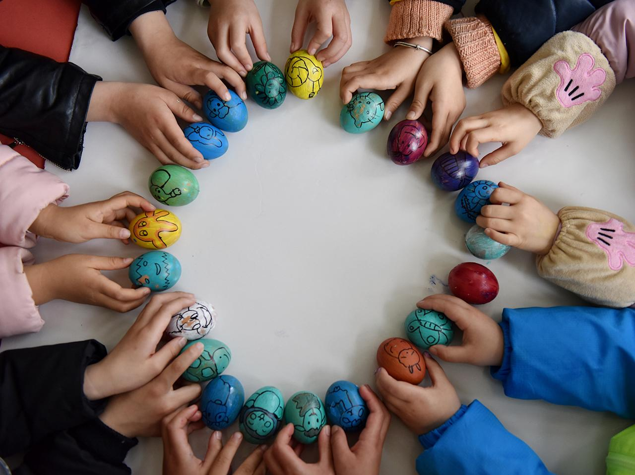 """<p>Childrenenjoy the game of """"egg balancing"""" on the Spring Equinox at a kindergarten in Chaohu on March 20, 2017 in Hefei, Anhui Province of China. People enjoy standing eggs on end to celebrate the Spring Equinox in China. (VCG via Getty Images) </p>"""