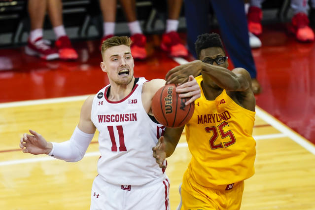 Wisconsin's Micah Potter (11) and Maryland's Jalen Smith (25) go after a rebound during the first half of an NCAA college basketball game Tuesday, Jan. 14, 2020, in Madison, Wis. (AP Photo/Andy Manis)