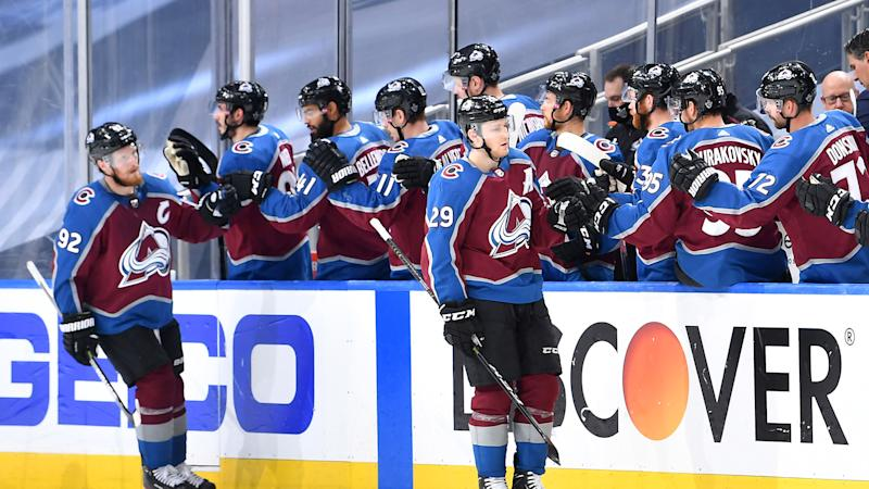 EDMONTON, ALBERTA - AUGUST 19: Gabriel Landeskog #92 and Nathan MacKinnon #29 of the Colorado Avalanche celebrate with teammates on the bench after MacKinnon scored in the second period of Game Five of the Western Conference First Round of the 2020 NHL Stanley Cup Playoff between the Arizona Coyotes and the Colorado Avalanche at Rogers Place on August 19, 2020 in Edmonton, Alberta. (Photo by Andy Devlin/NHLI via Getty Images)