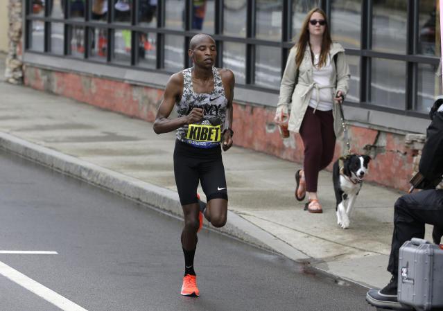 Elkanah Kibet, of Fountain, Colo., leads the pack during the 123rd Boston Marathon on Monday, April 15, 2019, in Framingham, Mass. (AP Photo/Steven Senne)